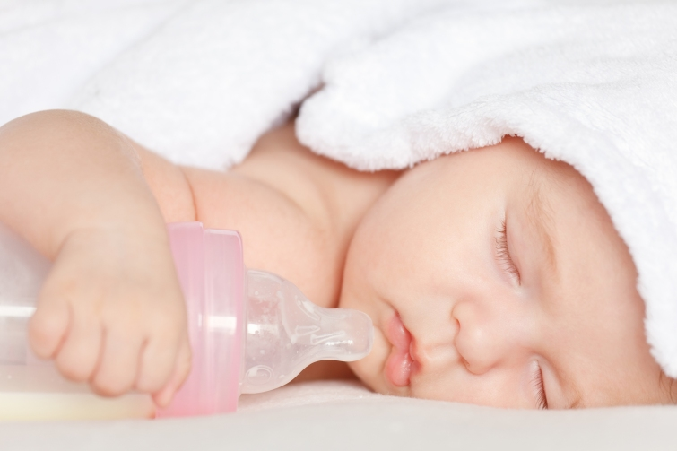 Sleeping baby with bottle, brampton dentist, dentists in brampton, kids dentist in brampton, brampton dental offices,